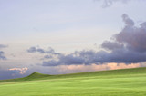 Beautiful view of golf course in English clountryside with drama poster