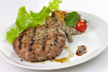 grilled hamburger with salad leaves