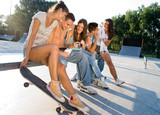Teens relaxing in skate park