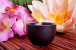 canvas print picture Spa candle and flower for aromatherapy