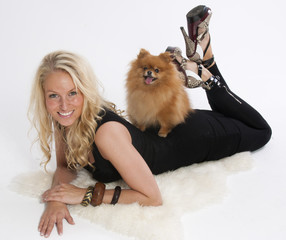 Blond young woman with her pomeranian dog