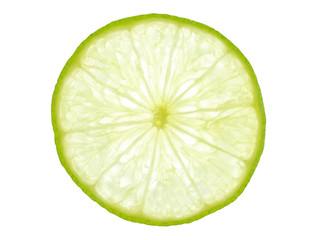 Green lemon slice backlit on white background