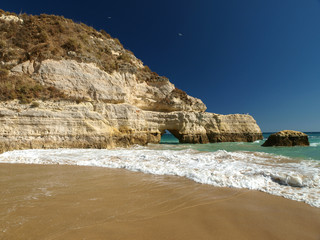 the idyllic Praia de Rocha beach on  Algarve region.