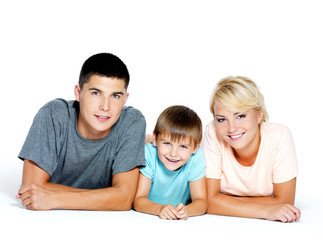 Portrait of an young  happy  family posing at studio