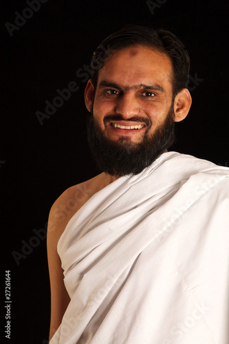 muslim pilgrim in white traditional clothes