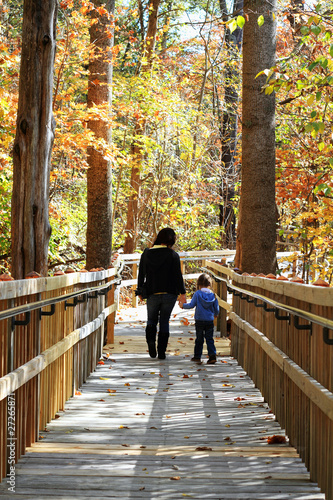 Young Mother and Child Walking