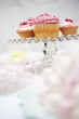 pink cupcakes on cakestand