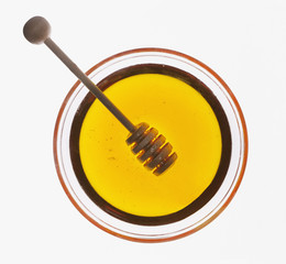 honey dipper in bowl of honey