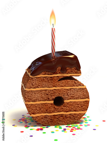 number six shaped birthday cake with lit candle and confetti