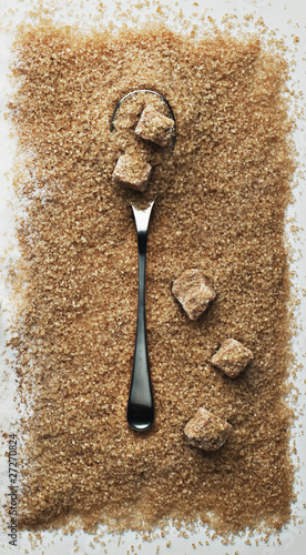 spoon in heap of turbinado sugar
