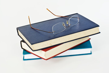 Glasses on closed books