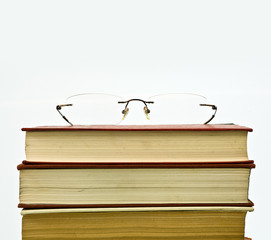 Glasses on reading books