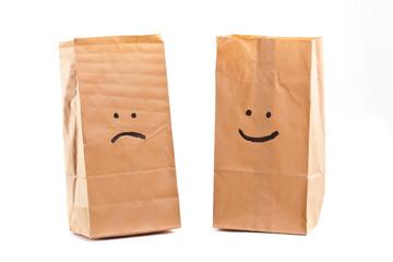Smiling paper bag. Concept.