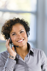smiling businesswoman wearing headset
