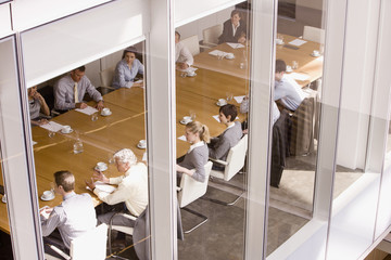 view of business people sitting in conference room