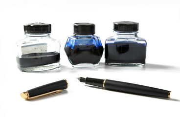 Small bottles with ink and  fountain pen