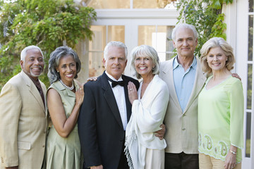 well-dressed senior couples smiling