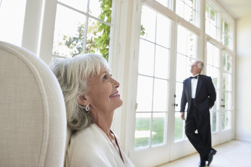 well-dressed senior couple in living room