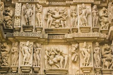 Erotic sculptures on ancient Hindu Temple at Khajuraho, India