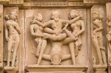 Erotic sculptures on  Hindu Temple at Khajuraho, India.