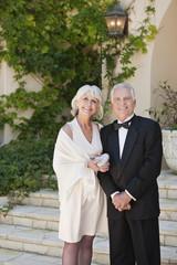 well-dressed senior couple smiling