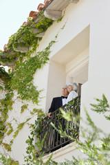 well-dressed senior couple on balcony
