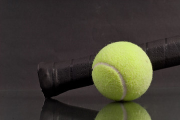 Tennis Ball with Tennis Racquet Handle with Reflection