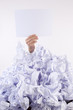 Businessman overwhelmed by the paper