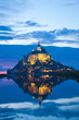 Mont Saint Michel abbaye reflected in the bay at sunset, France