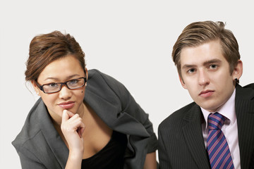 Young office workers listening with serious expression
