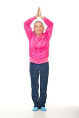 Aged woman doing yoga
