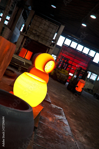 Hot forged steel balls In a forge environment.