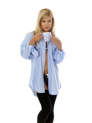 Young Woman Wearing  Blue Shirt Drinking Tea. Model Released