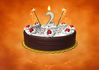 Two as Birthday candle lit on cherry cake