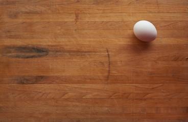 Single Egg on a Butcher Block Countertop