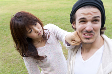 a young couple fighting in the park
