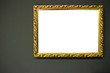 Antique empty golden frame on grunge wall