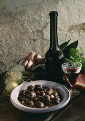 Snails cooked in red wine