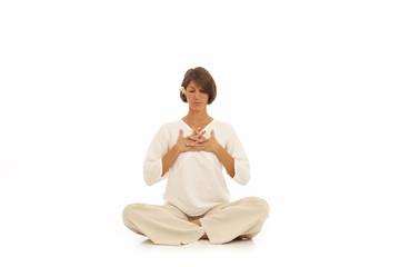 Young woman doing yoga Namaste Hands Pose