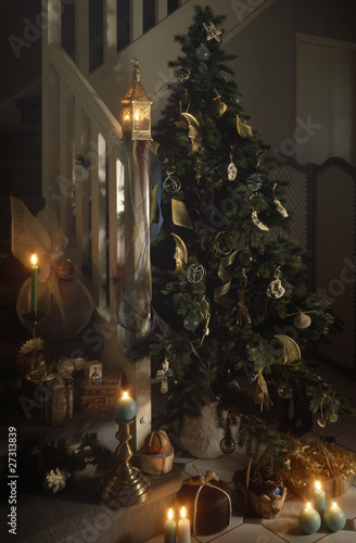 Decorated Christmas tree with gifts and candles