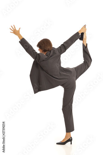 Young businesswoman in suit doing yoga Dancer Pose