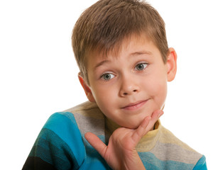 Closeup portrait of a doubtful boy isolated on white