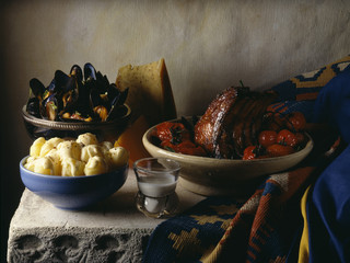 Roast pork with tomatoes,mussels and potatoes with gouda