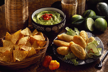 Mexican menu: red pepper fritters and guacamole