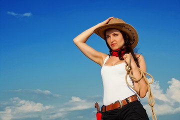 Beautiful cowgirl in a cowboy hat