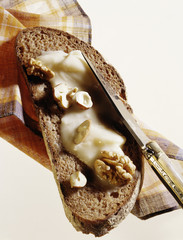 Slice of bread spread with creamy honey and walnuts