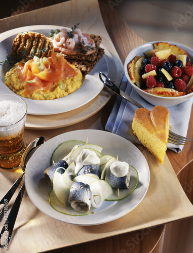 Rollmops with green apples,salmon scrambled eggs and fruit salad