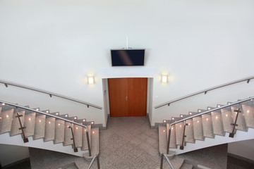 Two ladder flights and front entrance in  conference room