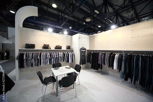 Exhibition hall with clothes on stands