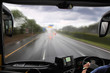 front window of bus and rainy road - 27318899